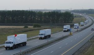 669584-a-russian-convoy-of-trucks-carrying-humanitarian-aid-for-ukraine-drives-along-a-road-near-the-city-o