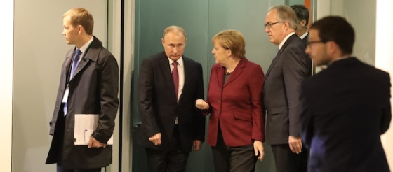 German chancellor Angela Merkel , right, accompanies Russia's president Vladimir Putin, second left, prior to  talks with French president Francois Hollande  and Ukraine's president Petro Poroshenko at the chancellery in Berlin Wednesday, Oct. 19, 2016.  ( Michael Kappeler/Pool Photo via AP)